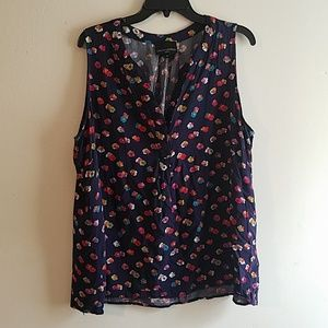 Blue tank with multicolored flowers
